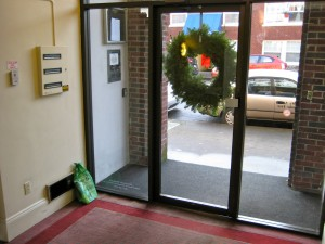 Christmas wreath on the door of an apartment building