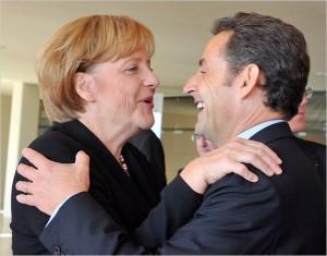 Nicolas Sarkozy and Angela Merkel hugging
