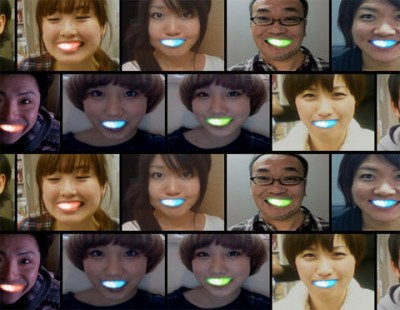 LED smile appliques on the teeth of Japanese teenagers