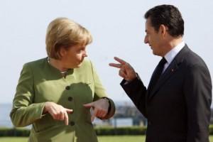 Nicolas Sarkozy and Angela Merkel talking together