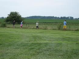 men urinating in a field