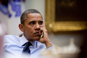 Obama leaning on hand deep in thought