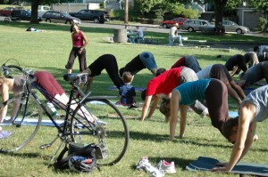 Bikers doing yoga in the park (Flickr by Elly Blue)