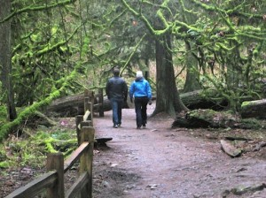 couple walking in Forest Park in Portland, Oregon