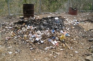 Smoldering Pile of Trash | burn piles (Flickr by Lee Shaver)
