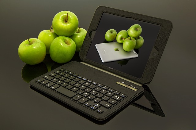 Pile of apples next to Apple iPad
