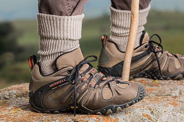 Close-up shot of a man wearing hiking boots outside