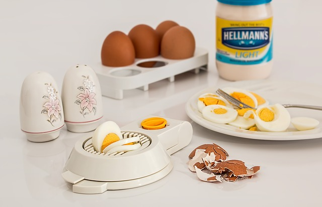 Eggs with egg slicer and jar of mayonaise
