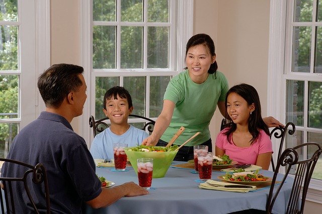 Family Eating Healthy Food at the Kitchen Table