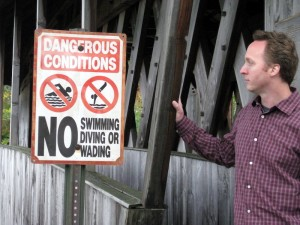 shawn radcliffe - yoga teacher - covered bridge - no swimming sign