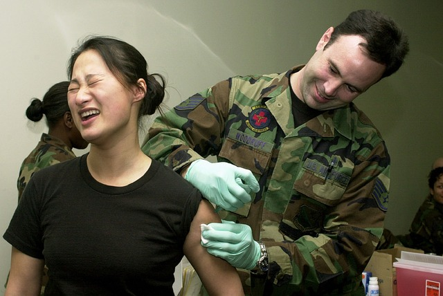 doctor giving a woman a vaccination in the arm