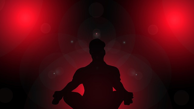 Silhouette of a person doing yoga meditation