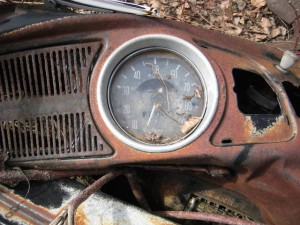 Slowing down: broken speedometer in abandoned car (by Shawn Radcliffe)