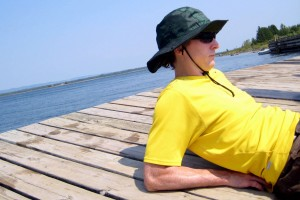 Man relaxing on a pier on Manitoulin Island, Ontario (by Shawn Radcliffe)