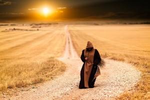 monk, hooded robe, walking, dirt road