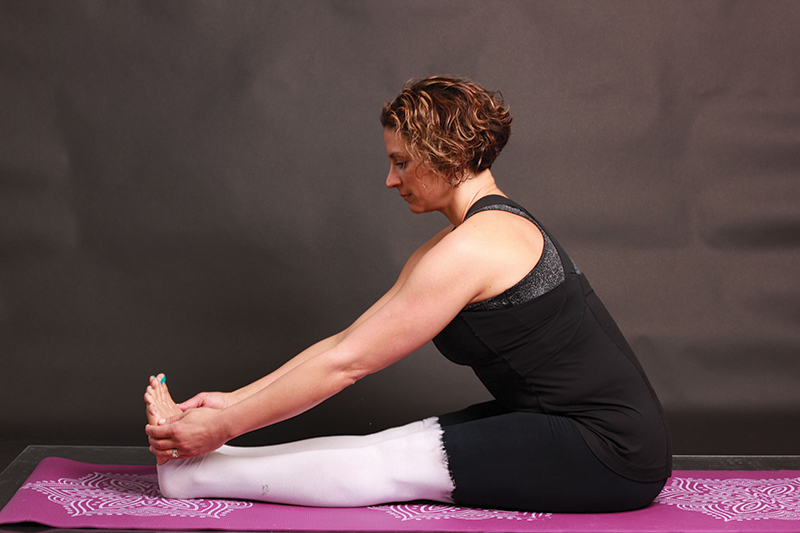 Woman doing yoga pose for Multiple Sclerosis, seated