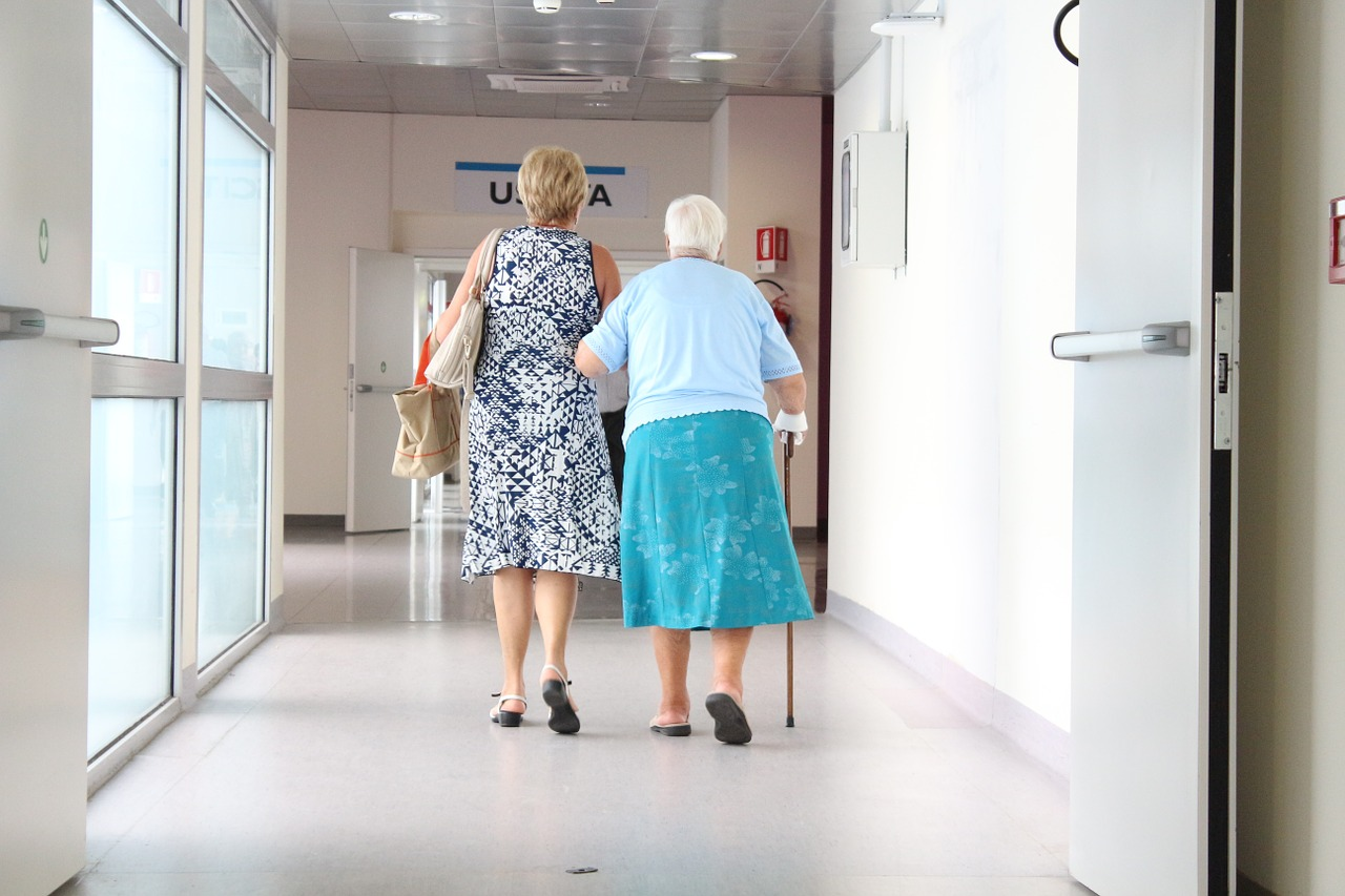 elderly woman, walking, hallway