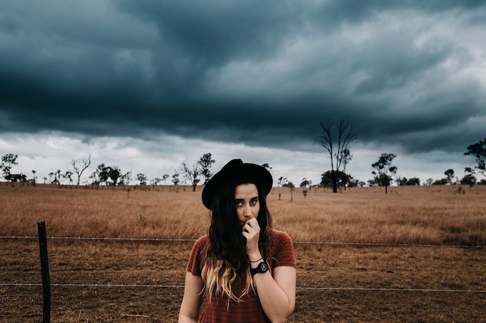 girl, storm, countryside, barbed wire fence